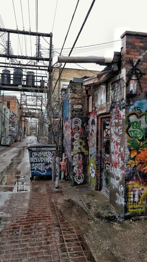 Graffiti Sky Day Outdoors No People Built Structure Architecture Back Alleys Service Corridors