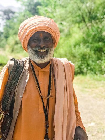 Portrait of sadhu standing on dirt road