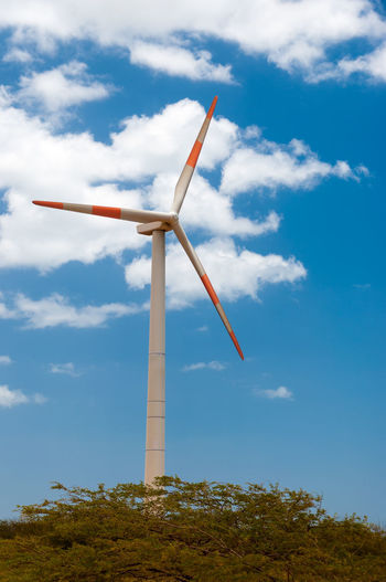 A windmill with a deep blue sky in La Guajira, Colombia Clouds Colombia Desert Desolate Dry Ecology Electricity  Environment Farm Generator Heat Industry Laguajira Land Mill Outdoors Power Renewable Rotate Rural Sky Technology Turbine Wind Windmill