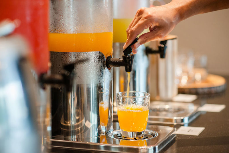 Drink Food And Drink Refreshment Human Hand Hand One Person Human Body Part Indoors  Glass Preparation  Real People Freshness Holding Drinking Glass Selective Focus Household Equipment Close-up Orange Color Food