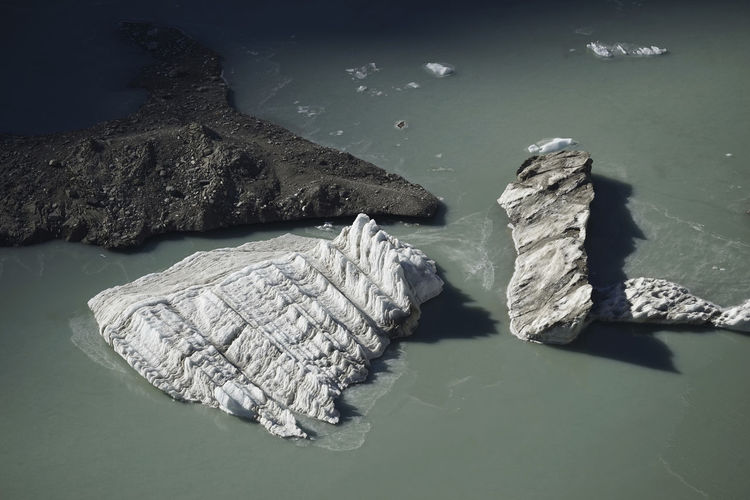High angle view of rocks floating on lake