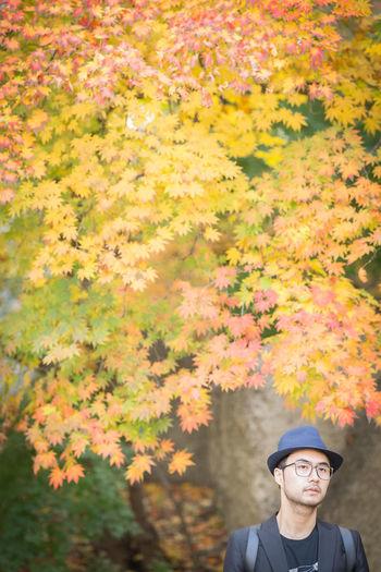 Man By Autumn Tree