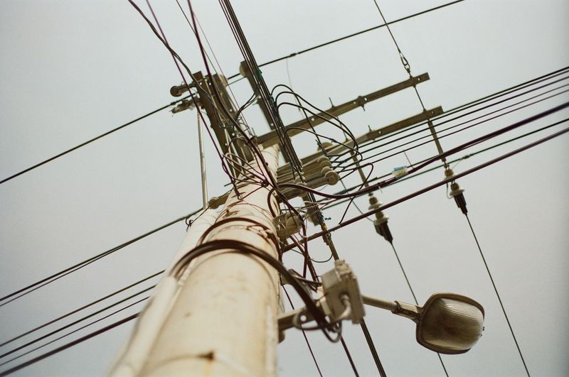 Low Angle View Cable Electricity  Connection Sky Power Line  Power Supply Technology Electricity Pylon Fuel And Power Generation No People Day Clear Sky Complexity Nature Outdoors Pole Telephone Line Telephone Pole Metal Directly Below Electrical Equipment My Best Photo