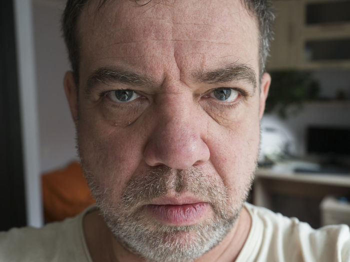 Portrait Headshot Close-up One Person Adult Front View Beard Looking At Camera Men Mature Adult Indoors  Facial Hair Males  Serious Mature Men Human Body Part Focus On Foreground Body Part Human Face Contemplation Depression - Sadness