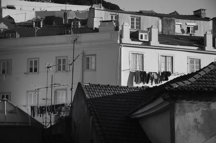 Sunny day ... Building Exterior Built Structure Architecture Window Residential Building Balcony No People Outdoors City Day Sky Tiled Roof  Sunlight Bwstreet Blackandwhite Black And White Light And Shadow Monochrome Lisboa Lisbon Sun Windows Sunny Day Sunny