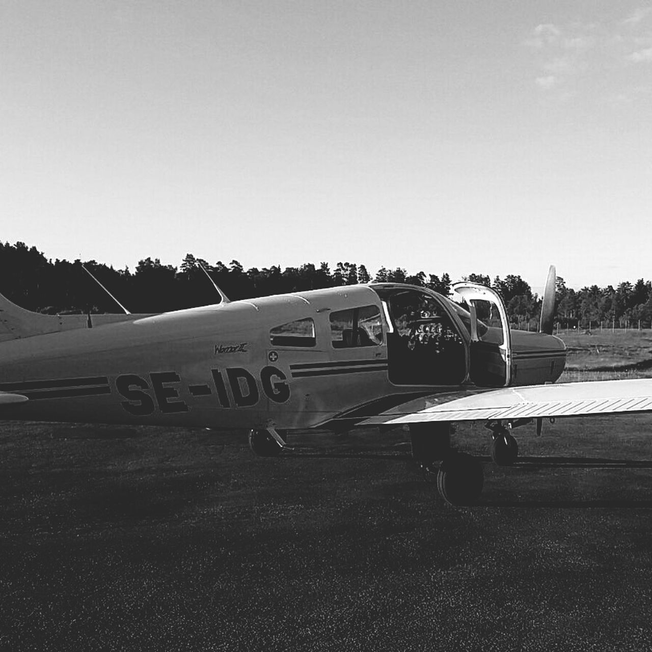 clear sky, transportation, sky, day, outdoors, old-fashioned, airplane, no people, tree, nature