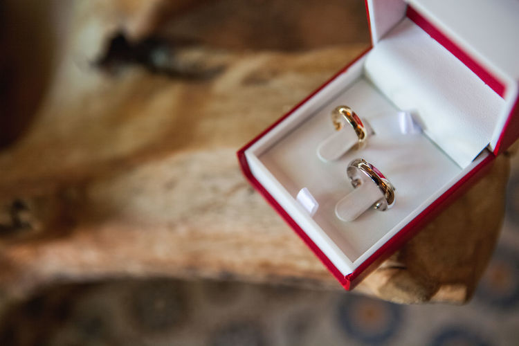 High angle view of engagement rings on table