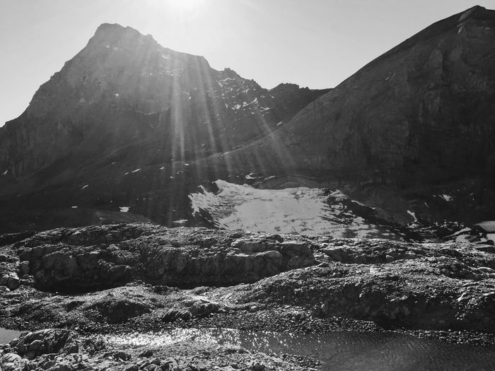 Sunset in swiss alps Alps Switzerland Sunlight Fall Blackandwhite Shadow Water Mountain Snow Sky Landscape Hiker