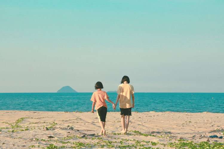 Holding Hands Holidays Sisterhood Sisters Strolling Backshot Beach Day Evening Leisure Time Lifestyles Malaysia Nature Sea Summer First Eyeem Photo