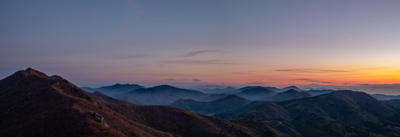 Panoramic view of mountain range during sunrise Mountain Sky Scenics - Nature Mountain Range Sunset Beauty In Nature Tranquil Scene Tranquility Cloud - Sky Environment Idyllic Nature Landscape Non-urban Scene Dusk No People Twilight Mountain Peak Orange Color Outdoors Mountain Ridge