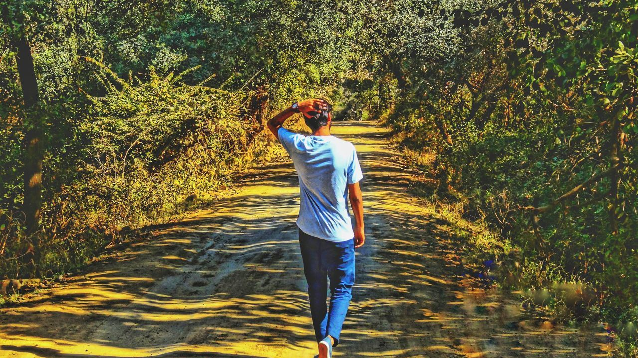 real people, water, one person, leisure activity, full length, casual clothing, lifestyles, nature, standing, tree, day, outdoors, walking, growth, young women, young adult, beauty in nature