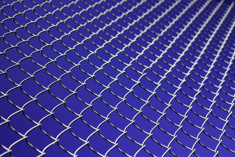 Full Frame Shot Of Chainlink Fence Against Clear Blue Sky