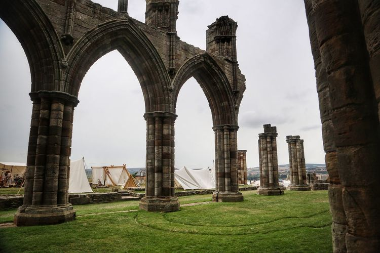 Whitby Whitby Whitby Abbey Architecture Built Structure Architectural Column Grass History Sky Ancient Nature The Past Arch Building Exterior Day Tourism Travel Destinations Old Ruin Travel Old Plant Outdoors Ancient Civilization No People Archaeology Ruined