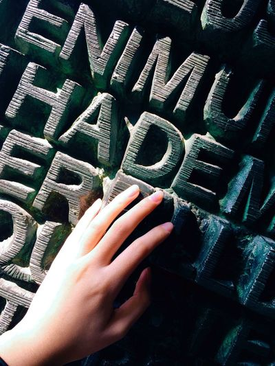 Human Hand Wall Of Letters Woman Hand Light And Shadow Contrast