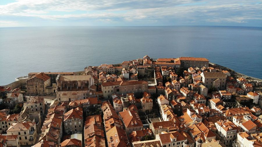 Croatia Dubrovnik Rooftop House Old Town Drone View Europe Built Structure Building Exterior Architecture Heritage Adriatic Sea Town Crowded Travel Travel Destinations Travel Photography Seascape Ocean Beautiful Place Medieval Mediterranean  Horizon Over Water High Angle View Cloud - Sky