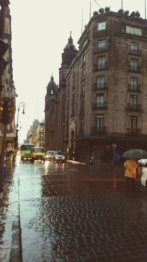 Rain Wet City Street Street Architecture City Water Building Exterior Built Structure Cityscape Politics And Government People Outdoors Day Puddle Adult Sky Adults Only