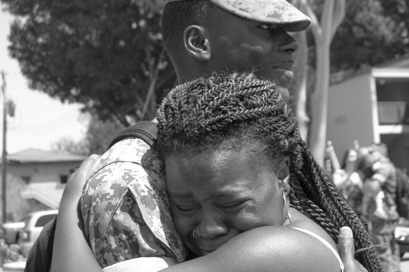Close-Up Of Woman Hugging Soldier