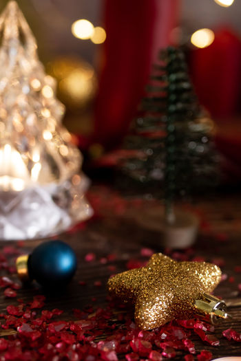 Christmas Holiday Celebration Christmas Decoration Christmas Ornament Decoration Indoors  Illuminated christmas tree Close-up Gift Holiday - Event Christmas Lights Event Tree Focus On Foreground Gold Colored Still Life No People Luxury Silver Colored Advent