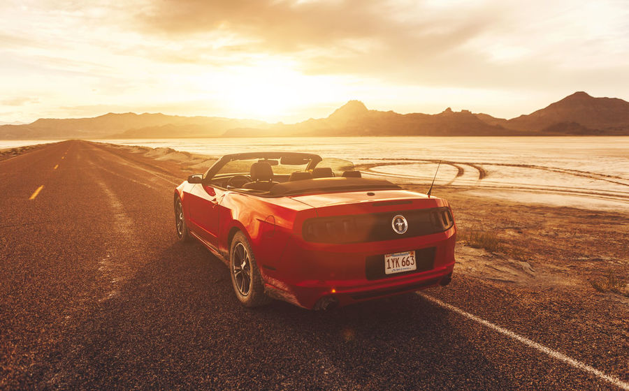 BONNEVILLE ,UTAH, USA JUNE 4, 2015: Photo of a Ford Mustang Convertible 2012 version at Bonneville Salt Flats,Utah,USA. The fifth generation began with the 2005 model year to 2014. Bonneville Salt Flats Classic Car Ford Mustang Muscle Cars Mustang USA Photos USAtrip Utah Bonnevillesaltflats Convertible Car Fordmustang Mountain Range Mustang American Muscle Red Color Salt - Mineral