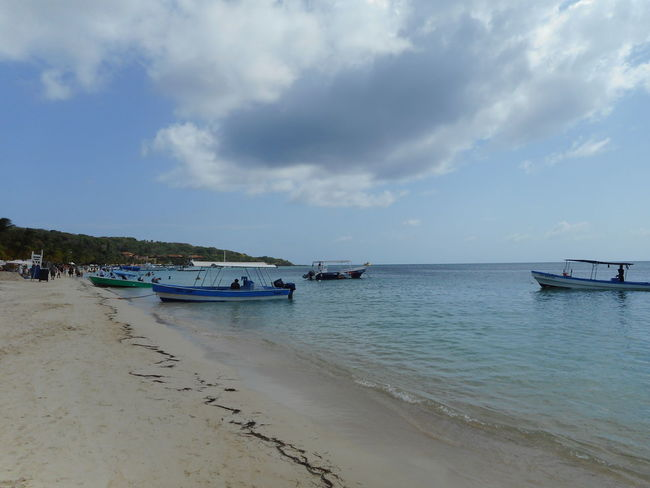 Honduras Roatan Bay Islands Beach Beauty In Nature Cloud - Sky Day Horizon Over Water Mode Of Transport Moored Nature Nautical Vessel No People Outdoors Sand Scenics Sea Sky Tranquil Scene Tranquility Transportation Travel Destinations Water