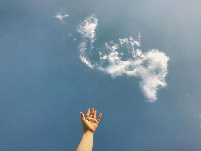 Arm against sky.