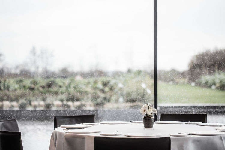 View of glass on table by window
