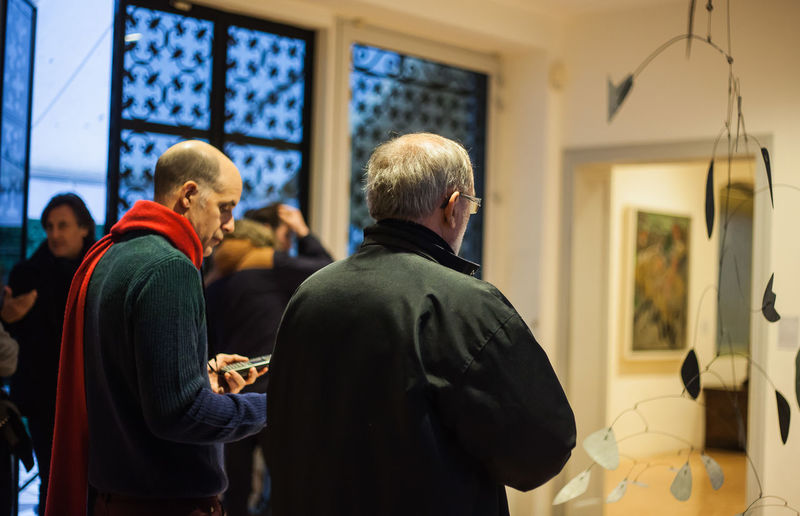 Peggy Guggenheim Collection Real People Men Indoors  Adult Group Of People Casual Clothing Standing People Women Males  Communication Warm Clothing Lifestyles Streetphotography Museum Museum Of Modern Art Venezia Italia Peggy Guggenheim Collection