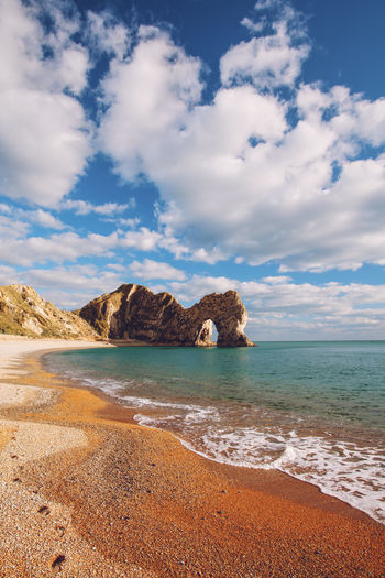 Durdle Door, Dorset, England Beach Clouds Day Dramatic Sky Durdle Door England Jurassic Coast Landscape Outdoors Sand Scenics Sea Sky Summer Travel Uk