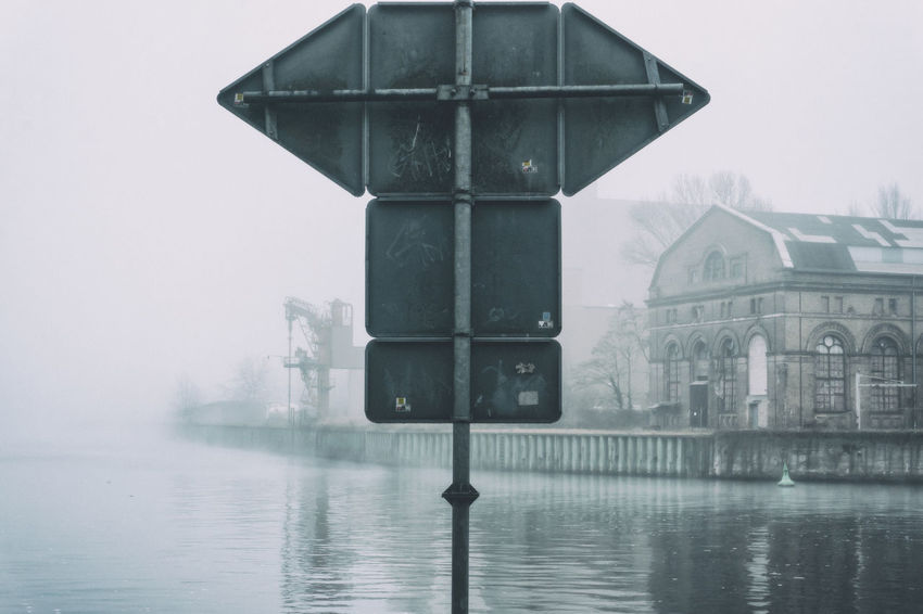 Back of signs at junction of Havel and Spree River on a foggy day in Spandau in Berlin, Germany Architecture Berlin Building Exterior Built Structure City Color Image Confluence Day Foggy Day Germany🇩🇪 Havel River Horizontal Junction Nature No People Outdoors Photography Reflection Signs Sky Spree River Berlin Tree Water Waterfront