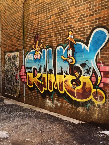 Graffiti Brick Wall Text Neon Multi Colored Outdoors Built Structure City No People Day Architecture Close-up