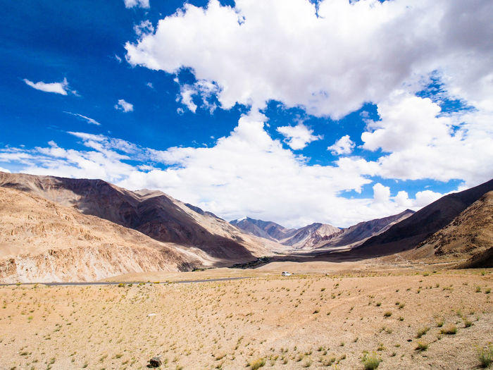 Arid Climate Beauty In Nature Climate Cloud - Sky Day Desert Environment Formation Idyllic Land Landscape Mountain Mountain Range Nature No People Non-urban Scene Outdoors Remote Scenics - Nature Sky Tranquil Scene Tranquility Travel Travel Destinations