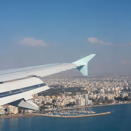 Sea Arrival Seascape Shore Colors Summertime Freshness Blue Blue Sky Cyprus Airplane Air Aircraft Wing Window High Sea Nautical Vessel Airplane Water RISK Sky Shore Flying Aeroplane Spread Wings Flight Aircraft Air Vehicle Airplane Wing Calm