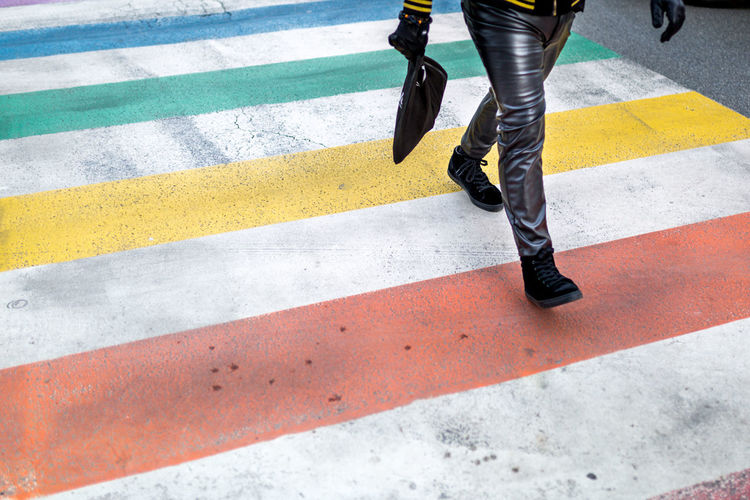 Rainbow in Bxls - Streets of Brussels (Bruxelles, BE, 2017) #Brussels #Colors #Crosswalk #Gay #GayNeighborhood #Leather #Rainbow #StreetPhotography #Village #Zebrapad Adult Adults Only Black Color City City Life Crossing Day Human Body Part Human Leg Low Section Modern Motion Multi Colored On The Move One Man Only One Person Only Men Outdoors Pedestrian People Road Road Marking Striped Walking Zebra Crossing