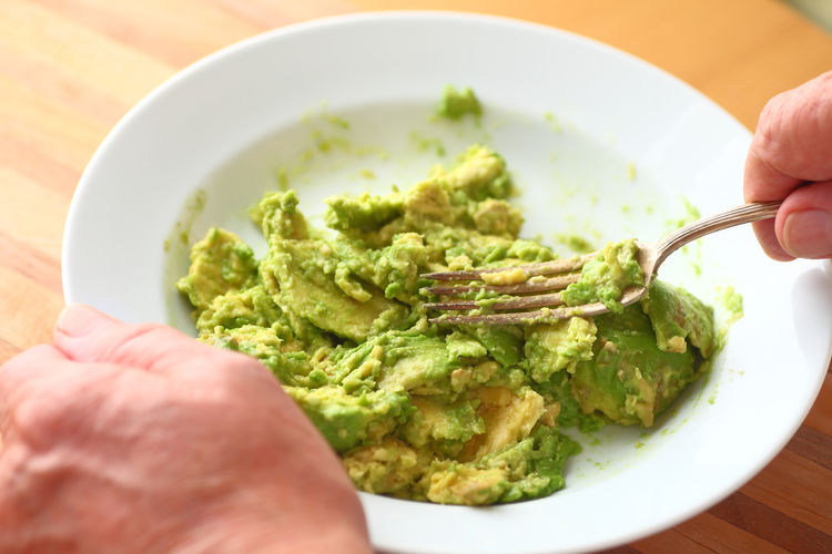 Bowl Close-up Creamy Day Fingers Food Preparation Fork Freshness Green Color Hands Healthy Eating Holding Home Food Homemade Food Indoors  Kitchen Skills Man Mashed Food Natural Light One Person Overhead View Textures Unrecognizable Person Vegetables