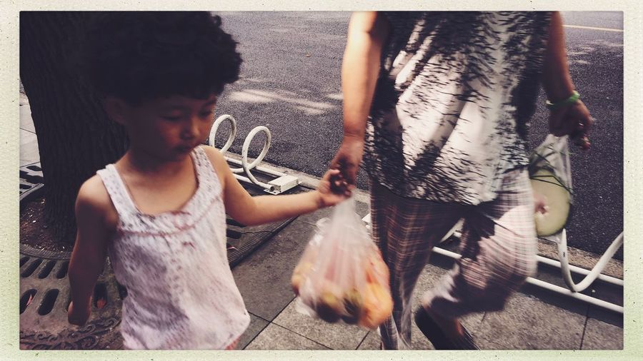 Shanghai Citylife Streetphotography Real People Transfer Print Child Auto Post Production Filter Lifestyles Childhood One Person Leisure Activity Casual Clothing Females Front View Day Women Vertebrate One Animal Girls Outdoors Innocence