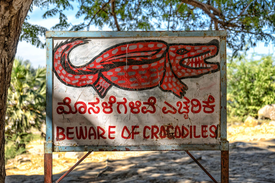 Best move on. Hampi, India. Art Beware Beware Of Crocodiles Close-up Color Colour Crocodile Danger Day Focus On Foreground Hampi  Illustration India Information Information Sign No Swimming Outdoors Painting Red Red Paint River Sign Sony A7 Text Travel