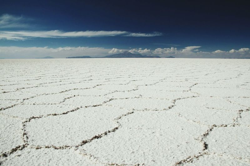 Bolivia Uyuni Salt Flat Dark Blue Sky Landscape_photography Salt - Mineral Salt Basin Tranquility Arid Climate Tranquil Scene No People Landscape Day Cloud - Sky Beauty In Nature Scenics Outdoors Cracked Sky Salt Flat Nature