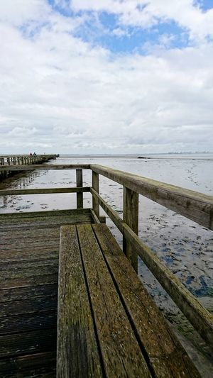 Butjadingen Sea Beach Pier Water Wood - Material Cloud - Sky No People Tranquility Outdoors Horizon Over Water Day Vacations Nature Jetty Sky Sand Scenics Beauty In Nature Travel Destinations Harbor Lost In The Landscape