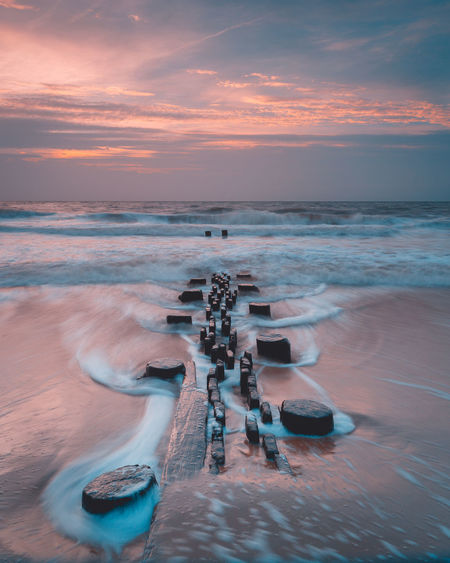 Seascapes from Rehoboth Beach, Delaware Aquatic Sport Beach Beauty In Nature Blurred Motion Cloud - Sky Horizon Horizon Over Water Land Long Exposure Motion Nature Scenics - Nature Sea Sky Sport Sunset Surfing Water Wave
