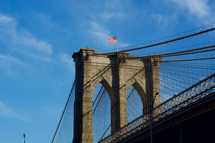 Architecture NYC Arch Architecture Bridge Bridge - Man Made Structure Built Structure Cloud - Sky Connection Day Engineering Flag Independence Low Angle View Nature Outdoors Patriotism Sky Suspension Bridge Tourism Transportation Travel Travel Destinations