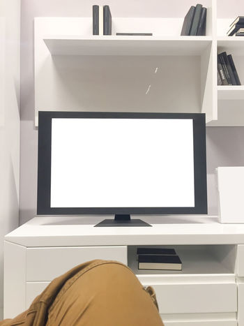 Copy Space Arts Culture And Entertainment Computer Day Device Screen Film Industry Flat Screen Home Interior Home Showcase Interior Human Hand Indoors  Leisure Activity Lifestyles Liquid-crystal Display Living Room MOVIE One Person People Speaker Technology Television Set Watching Tv