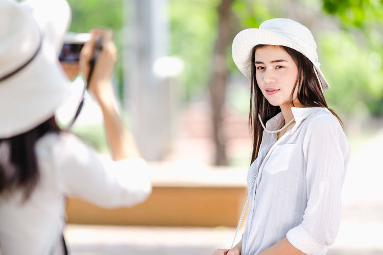 Portrait of woman wearing hat standing outdoors