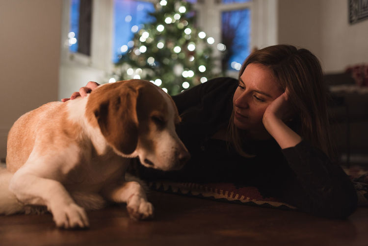 Animal Bonding Christmas Christmas Lights Contemplation Dog Domestic Life Eyes Closed  Fireplace Friendship Home Interior Indoors  Lifestyles Living Room Looking Down Love Lying Down One Animal One Person People Pets Always Be Cozy Sleeping Warm Young Adult