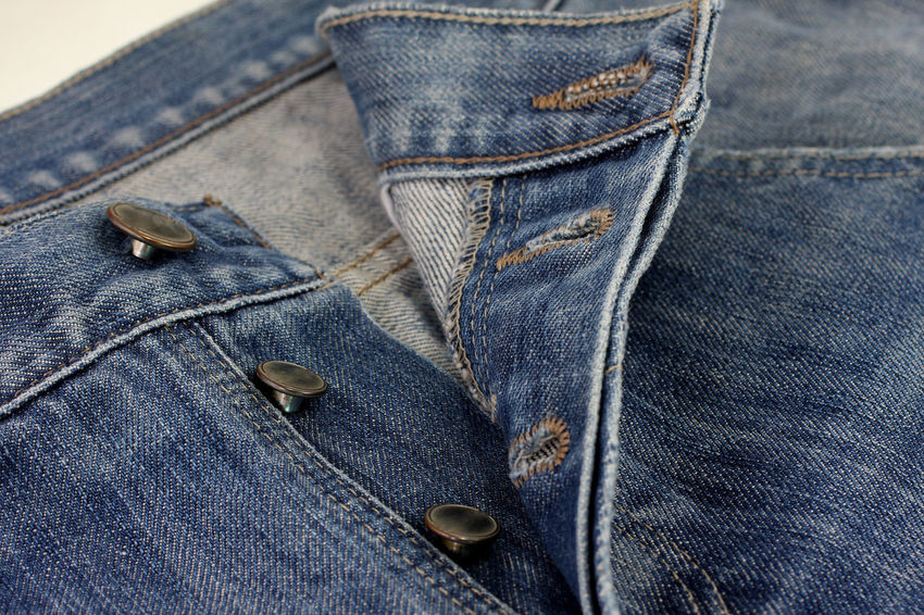 Jeans buttons close up Blue Button Casual Clothing Close-up Clothing Clothing; Garment; Fabric; Folded; Texture; Color; Skin; Background; Zipper; Isolated; White; Denim; Jean; Fashion; Close-up; Threadbare; Modern; Up; Cotton; Close; Blue; Pattern; Button Day Denim Denim Jacket Fashion Indoors  Jeans No People Pocket  Sewing Stitching Textile Textile Industry Textured