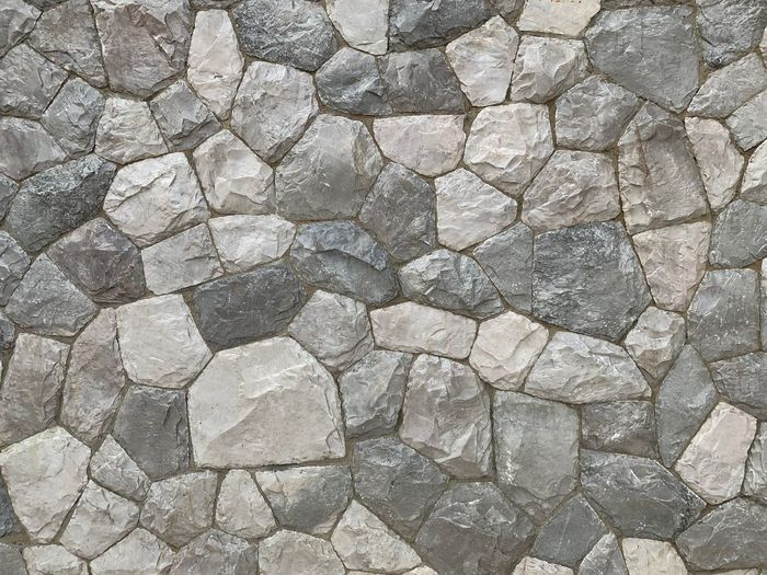 Textured  Backgrounds Solid Full Frame Stone Wall Stone Material Rough Stone - Object No People Pattern Architecture Wall Built Structure Rock - Object Nature Wall - Building Feature Rock Outdoors Close-up Gray Abstract Textured Effect Concrete