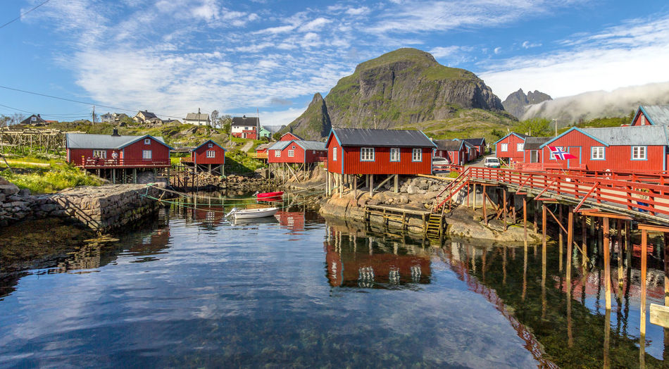 Lofoten Islands Norway Scandinavia Reflection Fisherman's Wharf Architecture Water Built Structure Mountain Sky Cloud - Sky Building Exterior Building House Nature Waterfront Day Scenics - Nature Beauty In Nature Lake Residential District Tranquility Outdoors Boathouse