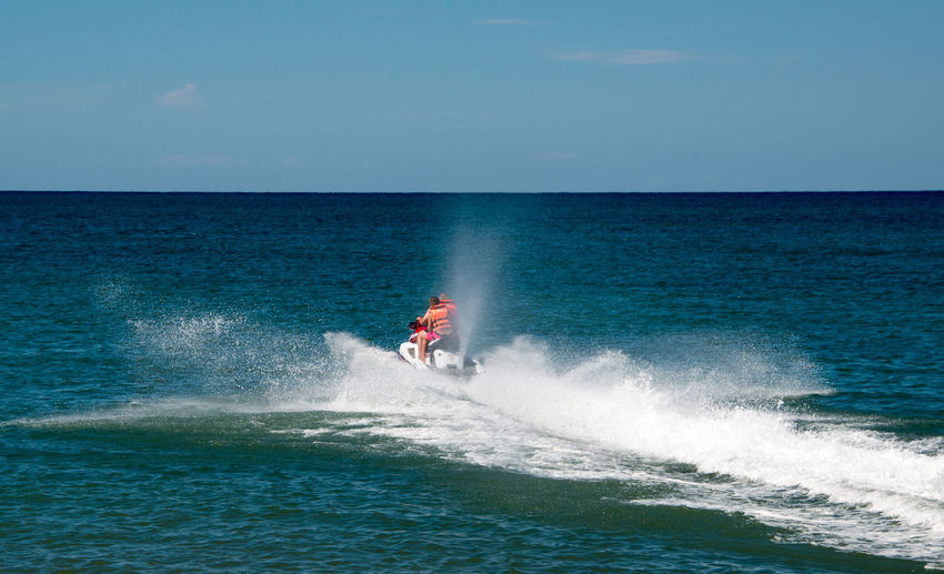 Adventure Beauty In Nature Clear Sky Day Extreme Sports Horizon Over Water Jet Boat Motion Nature Nautical Vessel One Person Outdoors People Scenics Sea Sky Speed Sport Spraying Surfing Vacations Wake - Water Water Waterfront Wave Summer Sports