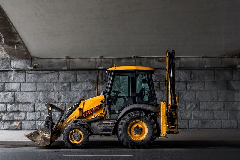 Transportation Mode Of Transportation Land Vehicle Wall - Building Feature No People Architecture Stationary City Day Motor Vehicle Wheel Road Outdoors Street Built Structure Car Machinery Abandoned Wall Parking