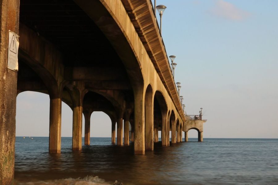 EyeEm Selects Water Built Structure Sky Architecture Connection Bridge Architectural Column Sea Nature Bridge - Man Made Structure Waterfront No People Transportation Day Arch Horizon Over Water Horizon Underneath Outdoors