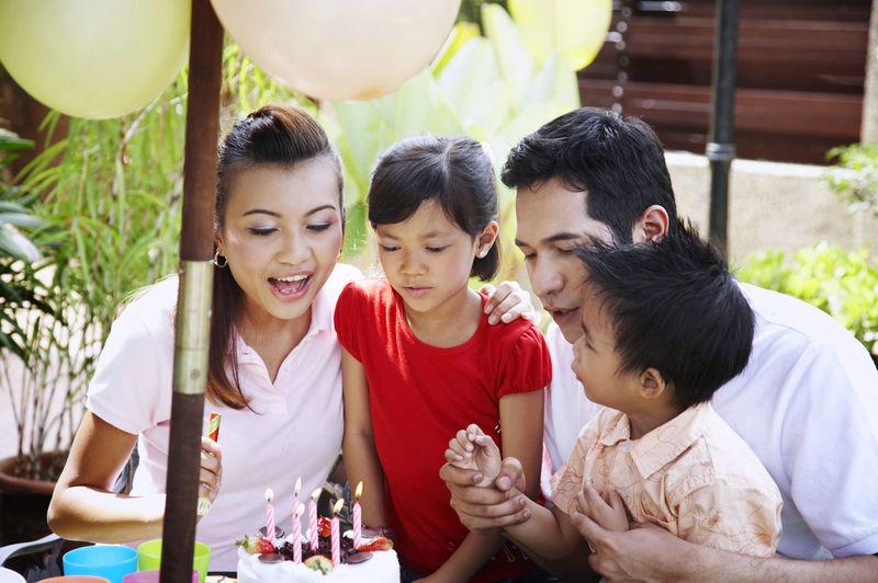 Family Celebrating Birthday In Lawn
